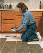 Installing Self-Stick Vinyl Tiles: use a stepped pattern and press with a floor roller when done