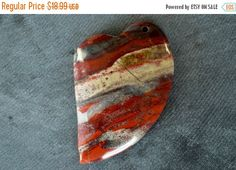 Gorgeous, designer stone pendant is genuine Rainbow Jasper.  All natural, no enhancements of any kind.  Beautiful colors of red, with some tan, and gray.  The shape is a heart, and the cut is perfect, with nice clean edges and drill hole, drilled from front to back.  The stone is rounded on the front, and flat on the back. Gorgeous, designer quality stone.  Stone measures 60x40x7mm.  Gemstone pendant is all natural, and one of a kind.    Please check my other listings…