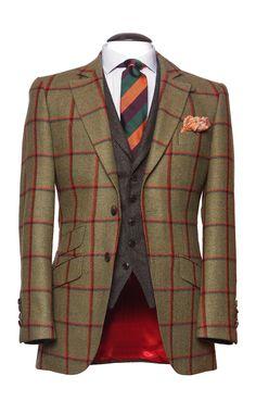 """Modèle """"Kensington"""" deux boutons, coupe anglaise cintrée, poches en biais et petite poche ticket. De vraies boutonnières aux manches, patte de fermeture détachable sous le col & surpiqûre soutenue sur les revers. Tissu tweed, vert à contre carreaux orange & chocolat, 100% Laine. #WicketSoBritish"""
