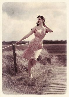 Cute vintage...pinup pose. The natural ones look so much better than the fabricated pinup style posters.