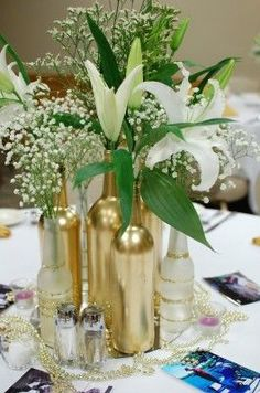 Gold centerpieces - spray paint wine and beer bottles for a 50th anniversary (or because you like gold!):