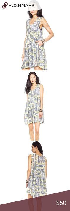 "Free People Dress Tunic Take Me To Thailand SMALL Free People ""Take Me To Thailand"" mini dress  Women's size Small Color: Fog Combo  Measurements: Armpit to armpit 17.5 in. Top of shoulder to front bottom hem 32.5 in.  **All measurements are approximate & taken with garment laying flat, not stretched.   Smoke free, Corgi loving home 🏡 Free People Dresses Mini"
