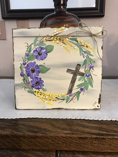 Pretty purple blooms on a wreath, a cross, and forsythia spring florals hand painted on a sturdy wood board. Comes prewrapped in a clear cellophane bag ready for gifting. Easter Paintings, Acrylic Paintings, Easter Cross, Easter Art, Easter Ideas, Cross Art, Bear Decor, Angel Decor, Spring Painting