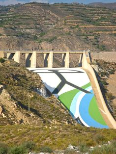 The Indalo symbol is so common in Almería. Not only is it a good luck souvenir, it is also part of the culture of this part of Spain - seen here built into the dam in Cuevas del Almanzora
