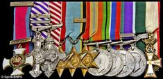 Air Cdre Sismore's medals rack - DSO, DFC**, AFC, Danish Knight of the Order of the Dannebrog cross. Ace pilot/Nav first RAF daylight raid.