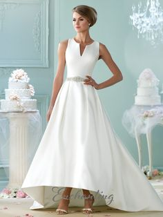 Sleeveless Mikado A-line gown, scoop neckline with V-cut out, double strap X-back with bow detail, beaded natural waistline, high-low skirt with side pockets, sweep train. Sizes: 4 – 20, 16W – 26W Colors: Ivory, Gold