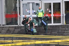 MANCHESTER, ENGLAND - OCTOBER 11: Paramedics exit Arndale shopping centre, where a man allegedly stabbed five people on October 11, 2019 in Manchester, England. A man in his 40s was arrested on suspicion of assault, as paramedics treated five people for stab wounds at Manchester Arndale, a large shopping complex in the city centre. (Photo by Anthony Devlin/Getty Images) via @AOL_Lifestyle