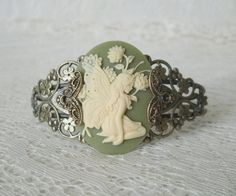 This beautiful antique gold brass filigree cuff bracelet has a fairy cameo with antique gold brass filigree accents on the sides. Fairy Jewelry, Art Deco Jewelry, Jewelry Sets, Jewelry Design, Magical Jewelry, Cameo Jewelry, Renaissance Jewelry, Victorian Jewelry, Vintage Jewelry