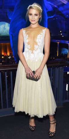 Dianna Agron tread the line between racy and romantic at the 2014 Museum Gala in an ethereal ivory-and-white lace tea-length dress, accessorizing with a white feather-embellished headband, a gunmetal Bottega Veneta minaudiere, and black double-strap Charlotte Olympia heels.