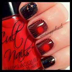 Black and red designs off-set with black/red glitter nails