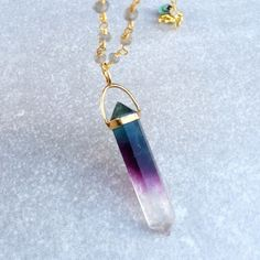 """Healing Fluorite Crystal Point Gold Necklace 18"""" Sometimes we need a simple, yet bold necklace to make an outfit pop. The pendant is a superb Fluorite specimen that has gradation of clear, purple, indigo and teal blue. This is naturally occurring, not dyed. The crystal hangs from a vermeil pendant bail and is stamped 925. Vermeil is 24k gold plated over solid Sterling silver. The rosary chain is made from tiny labradorite beads and 24k gold plated wire. The links of the chain are double…"""