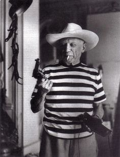 Picasso with pistol and cowboyhat, 1958