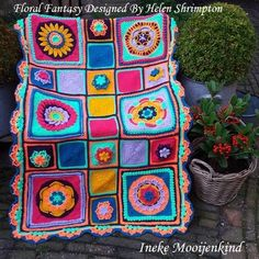 Lapghan made with squares from the E-book Floral Fantasy of Helen Shrimpton
