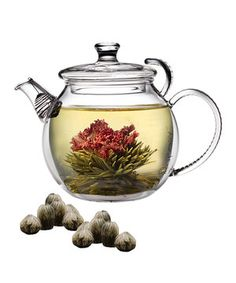 A hand-blown and heat-resistant borosilicate glass teapot features contemporary detailing on the lid and provides a perfect viewing area to watch tea blossoms bloom gracefully into stunning arrangements. An included filter means that brewing loose-leaf teas is superbly simple as well. Each included blossoming bud is hand-sewn with the highest-quality carnations and Silver Needle White Tea and can brew up to 50 ounces. Learn more
