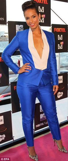 Flawless: The singer's dark hair was piled into an updo and she wore dark eye make-up and pink lipstick to complete the look Blue And White Suit, Bright Blue Suit, Alicia Keys Style, Celebs, Female Celebrities, Fashion Line, Black Girl Magic, Dark Hair, Well Dressed