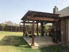 This is a picture of a beautiful Flagstone patio and Pergola Groundscape installed for a customer in Fort Worth Texas. If you would like an estimate for your own pergola or flagstone patio give us a call at Stone Patios, Flagstone Patio, Landscaping Company, Sidewalks, Back Patio, Walkways, Patio Design, Fort Worth, Patio Ideas