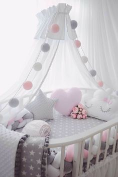 Girls , we should do Gray and white as the main colors regardless of the sex. Then add blue or pink.  I love these round cribs.