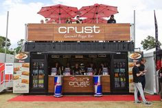 Crust gourmet pizza bar built by price and speed with modified containers. 20' shipping containers were used to create the stall.