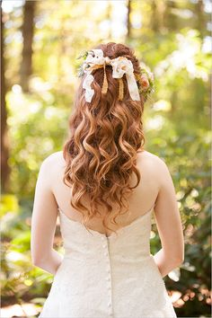 Cascading curls and flowers wedding hair