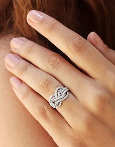http://rubies.work/0114-ruby-rings/ Infinity knot diamond engagement ring from @sillyshiny