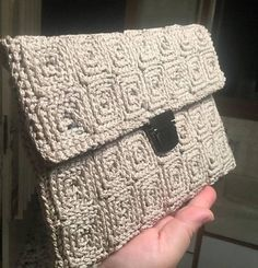 Women wallet crocheted on plastic canvas 5 mm with polypropylene cordon for bags in beige color .Dimensions height 18 cm and length 26 cm. That is a my video for to how crochet on plastic canvas 5 mm : https://www.youtube.com/watch?v=GwTBrXWPrtY