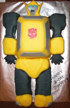 Cartoon Bumblebee - Transformer cake for a 4 year olds b-day. Vanilla cake covered in Fondant. Thanks for looking!