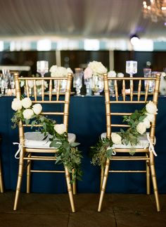 Gold Chiavari Chair dressed with white roses Photo Credit: Marni Rothschild
