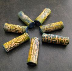Set of 2 yellow and green flared hollow tube by stillpointworks