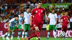 Fernando Torres of Spain scores the opening goal