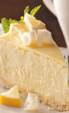 Lemony White Chocolate Cheesecake is part of Desserts Although it takes some time to prepare this eyecatching cheesecake, the combination of tangy lemon and rich white chocolate is hard to beat It' - 13 Desserts, Lemon Desserts, Lemon Recipes, Sweet Recipes, Baking Recipes, Delicious Desserts, Dessert Recipes, Yummy Food, Filipino Desserts