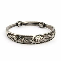 Beautiful Butterfly and Lotus Bali Bangle Bracelet Eve's Addiction. $36.00. Approximate Weight: 38.3 grams