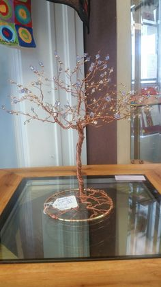 1' Violet Swarovski crystal and recycled copper wire tree. $75, one of a kind.