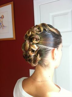 Sectioned ballroom updo with loops and swirls. Good hairstyle for standard and latin. Visit http://ballroomguide.com/comp/hair_make_up.html for more hair and makeup info