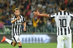 Claudio Marchisio (R) of Juventus FC celebrates a goal during the Serie A match between Juventus FC and Udinese Calcio at Juventus Arena on September 13, 2014 in Turin, Italy.