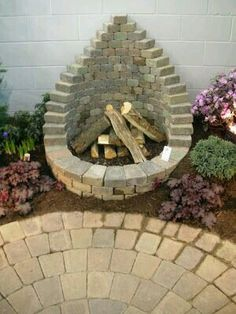 Outdoor fireplace - could use same brick setup for waterfall/small pond