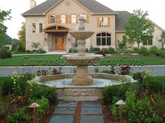 This hand carved granite fountain by Carved Stone Creations is a great addition to the homeowner's yard and the neighborhood. Slate pavers and landscaping make for a beautiful presentation too. Click on the image to see a gallery of fountain projects by Carved Stone Creations. #landscape #design #fountain