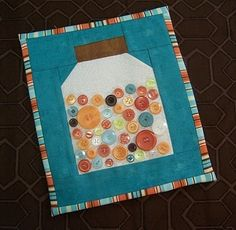 Sew a Button Jar Quilted Wall Hanging ~ how cute & would be great to do with some of my great aunt & grandmothers buttons!