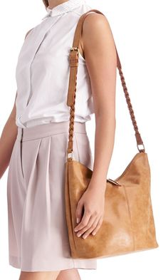 Medium cognac bucket bag with braided shoulder straps