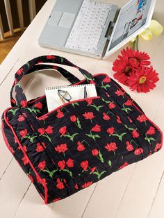 "On the Go Laptop Cover      Technique - Sewing    Use this pocketed carrier for your laptop or any important papers. Quilted with a thin layer of batting, it will gently protect your valuables. This e-pattern was originally published in Sew It in a Weekend.     Size: 15"" x 12"" x 3""."