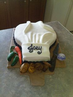 Chef's cake ..... would be cute to do it on a real (new) cutting board instead of a traditional cake board...