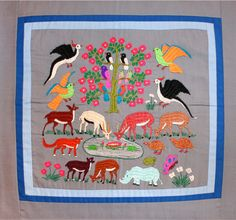Hmong Embroidery - Animals  This piece is a wild animal paj ntaub, with commonly hunted animals pictured, and with the exception of the rhinoceros which is also part of the scene. The Hmong believe the rhinoceros has healing properties. In the center is a group of deer, eating grass and drinking water from a pond. A pair of quail is heading toward the pool of water, as well as pheasants and other birds. The technique used involved surface stitching.