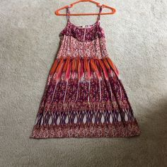 Floral Sun Dress Spaghetti strap dress with purple,pink, and orange floral. Xhilaration Dresses Midi