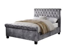 Flair Furnishings Lola Fabric Bedframe Silver Kingsize (5'0) - The Lola Fabric Bed Frame consists of a modern, sleigh style design with a cushioned and buttoned headboard which gives the bed frame a luxurious feel. This bed frame is available in a striking silver velour fabric, sure to catch the eye and be the focal point of any bedroom.
