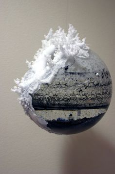 Beilil Liu-glass globe filled with salt, water + carbon powder. Salt crystals grow along the globe surface while water evaporates.