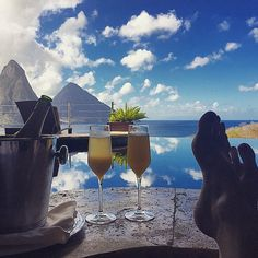 Mimosas for Friday morning breakfast... with the added bonus of a fantastic view of the magnificent Pitons..........Priceless! Thanks for the awesome photo Cassondra Billedeau @cassondranyc #repost #tgif #pitons #view #birthday #mimosas #futab #s...