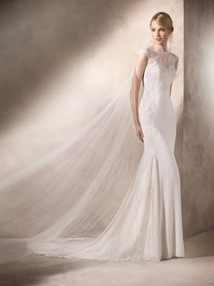 La Sposa HUDSON Sensual mermaid dress with bateau neckline and Chantilly lace applique on necklace and side of leg to form part of the train.