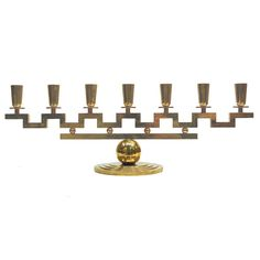 Lars Holmstrom  Candelabra | From a unique collection of antique and modern candleholders and candelabra at http://www.1stdibs.com/furniture/lighting/candleholders-candelabra/