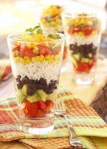 Layered Fiesta Rice Salad (also great for parties served in glassware): brown rice, olive oil, lime juice, gumin, honey, garlic, bell pepper, avocado, black beans, mango, corn kernels, green onion, cheddar cheese, cilantro