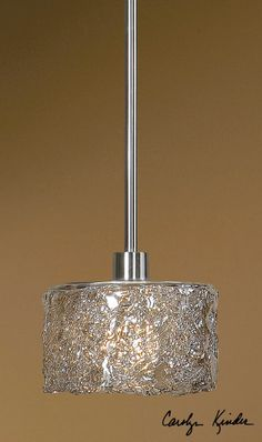 Sugar Spun glass paired with satin nickel designs. Eye catching elegance.