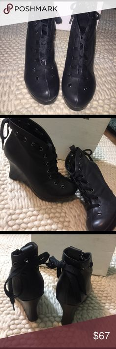 """Cool, Casual wedge platform boots Black 4"""" wedge boots with lacing all around the boot. Has a small scratch as evidence by the pictures. The bottom of the shoe had the magnetic stickers and that's why it looks like that. Urban Outfitters Shoes Lace Up Boots"""